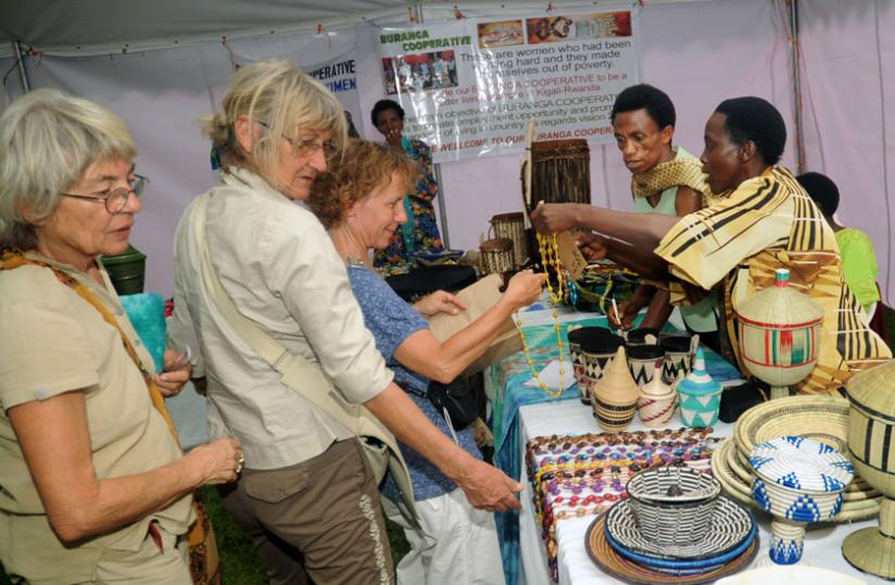 1413753286Foreign-visitors-buy-crafts-from-a-women-cooperative-in-Kigali-last-year