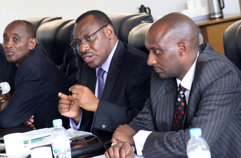 Minister Gatete makes a point during his appearance before PAC members at Parliament yesterday, while the Director General, Rwanda Public Procurement Authority, Augustus Seminega (L), and the Commissioner General, Rwanda Revenue Authority, Richard Tusabe (R), look on. (John Mbanda)