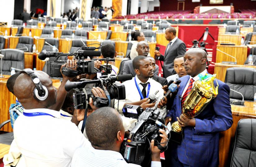 Kicukiro mayor Paul Jules Ndamage speaks to journalists after his district emerged the top performer for the third year running on September 12. (Timothy Kisambira)