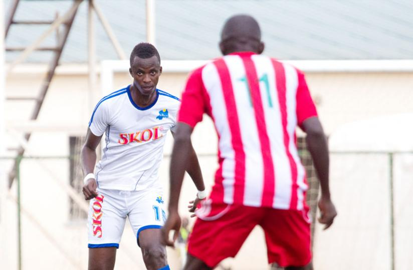 Rayon Sports defender Faustin Usengimana (L) in a league tie against Musanze. Bralirwa refused to renew sponsorship because the club is sponsored by rivals Skol. (T. Kisambira)