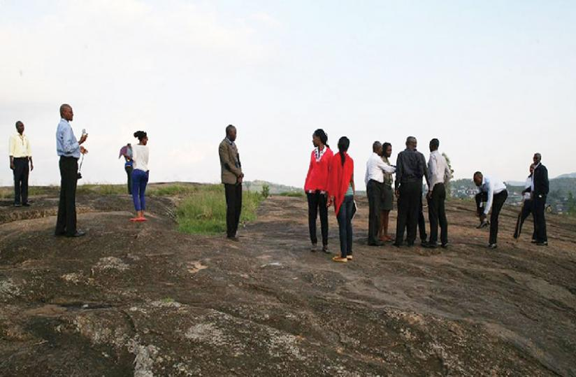 Members of Institute of National Museums of Rwanda on a study tour at the site. (David Nkusi)