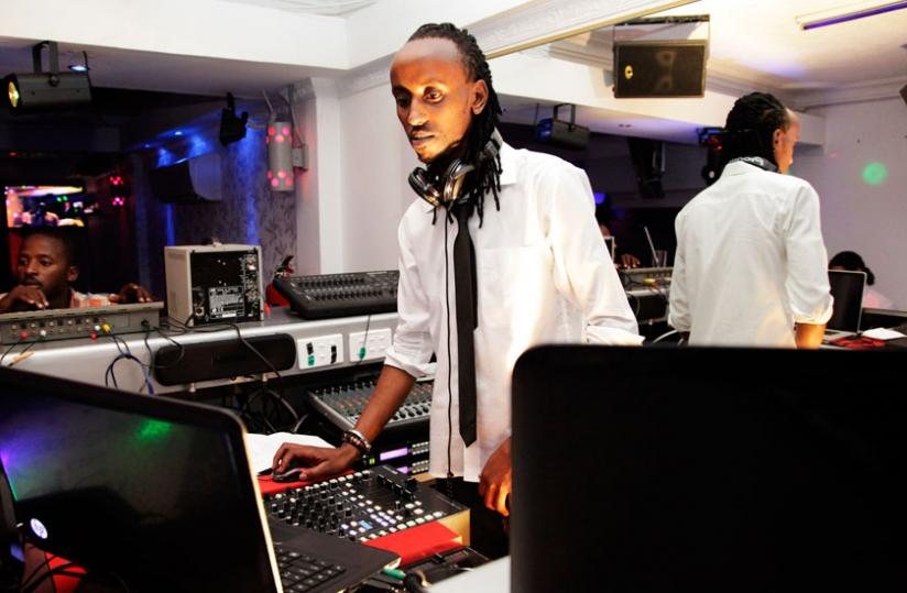 A Deejay plays music in one of the licensed night clubs in Kigali. (File)