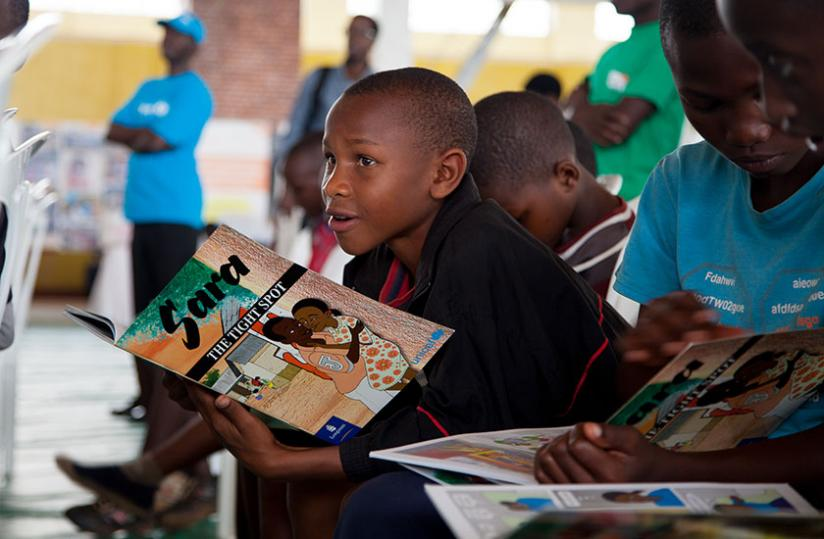 Children were given books to read during the celebrations. (Doreen Umutesi)
