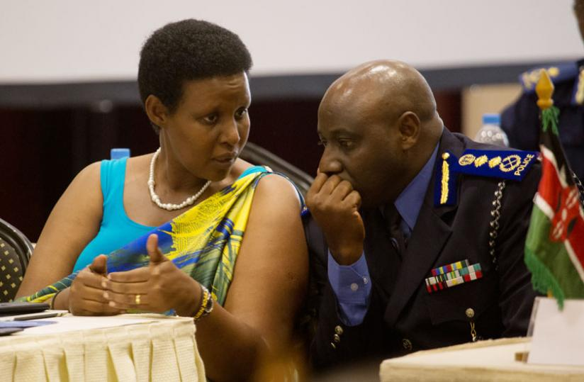 Gender and Family Promotion minister Oda Gasinzigwa chats with IGP Emmanuel Gasana at the annual General Assembly of the Kigali International Conference Declaration (KICD) in Kigali yesterday.(Timothy Kisambira)
