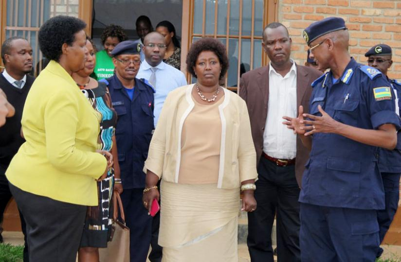 Ministers Gasinzigwa (L) and Dr Binagwaho (C) and other officials on a guided tour of the rehab centre in Huye yesterday. (J.P. Bucyensenge)