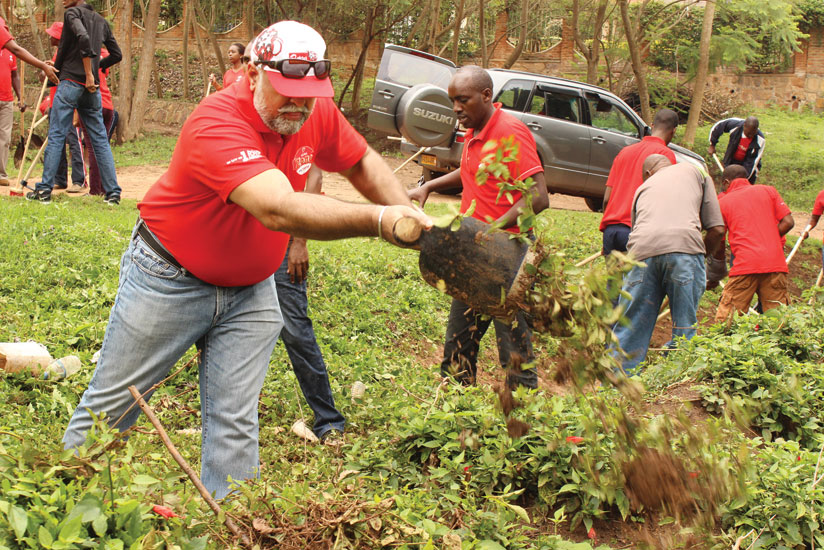 Airtel chief, Teddy Bhullar (left),  and the telecom's staff participate in the monthly community service (Umuganda) last year. It is important for organisations to support community initiatives to remain relevant and win people's goodwill. (File)