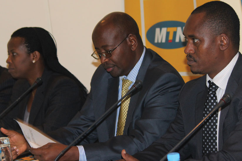 L-R: Minister of State for Energy Germaine Kamayirase, Musoni and  Sano at the launch of the e-payment system. (Clement Uwiringimana)