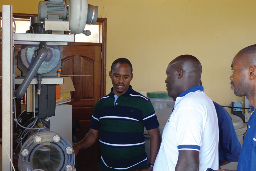 Sano (left) on a field tour of one of the water treatment plants. WASAC is looking to pump adequate water by 2017. (Courtesy)