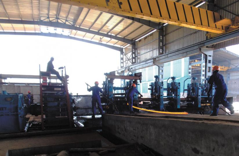 Workers fix equipment at the plant that is expected to create 300 jobs. (Courtesy)