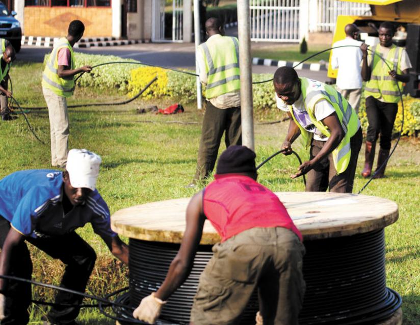 Workers lay fibre optic cables in Kimihurura, Kigali. Affordable internet is key for development. (File)