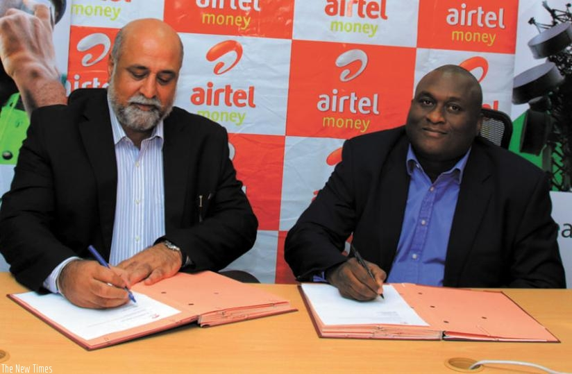 Bhullar (left) and Iluyemi during the signing of the agreement on Wednesday in Kigali. (Courtesy)
