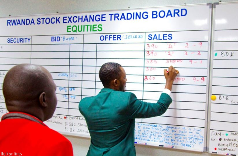 A broker conducts bussiness at the stock market. The Rwf15 billion Treasury bond (TB) issued by the central bank on Wednesday has attracted more retail investors compared to that issued in November.(Timothy Kisambira)