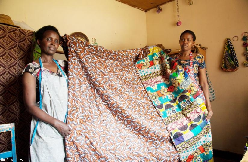 The ladies show a bedspread they made in Kitenge material (Faustin Niyigena)