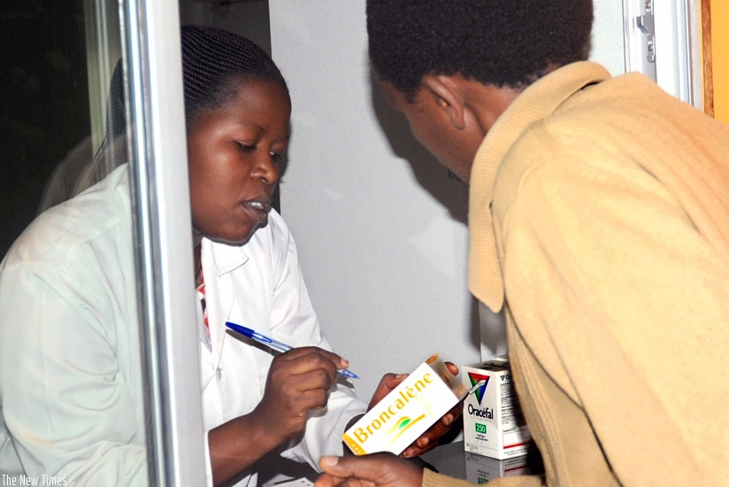 A pharmacist prescribes drugs for a patient at a Kigali pharmacy recently. (File)