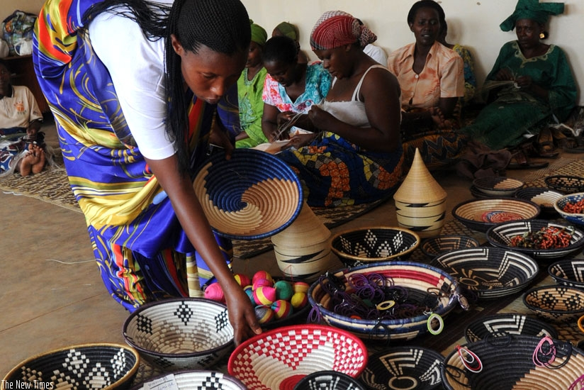 Women weaving baskets to support their families. (John Mbanda)