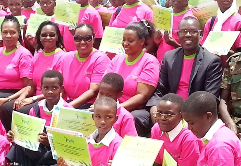 Some of the girls show their certificates in a group photo with Imbuto officials. Courtesy.