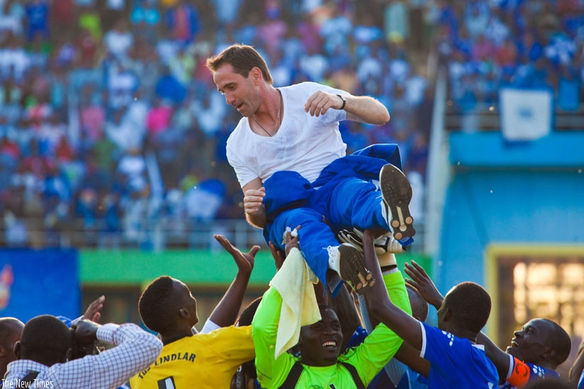 Rayon Sports players and fans lift Gomes after he guided the club to the 2013 league title. (File)