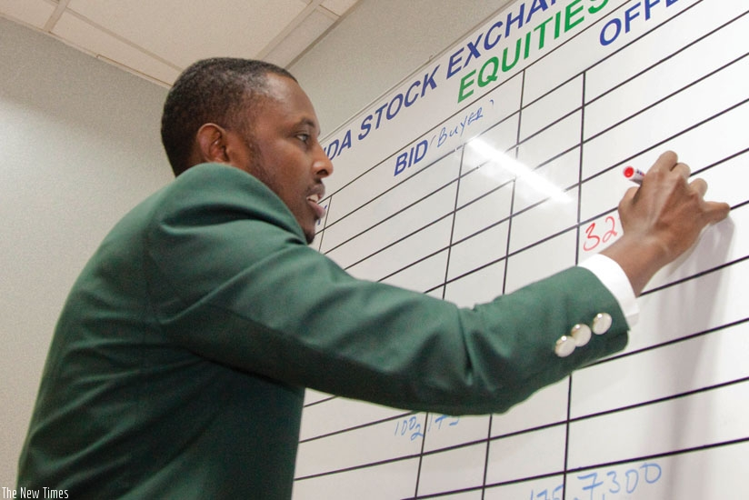 An RSE staff records deals during a recent trading session on the bourse.