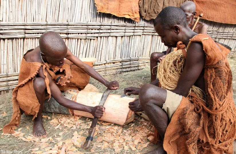 Culture enthusiasts illustrate how to make back cloth at Nyanza Museum last year. (Timothy Kisambira)