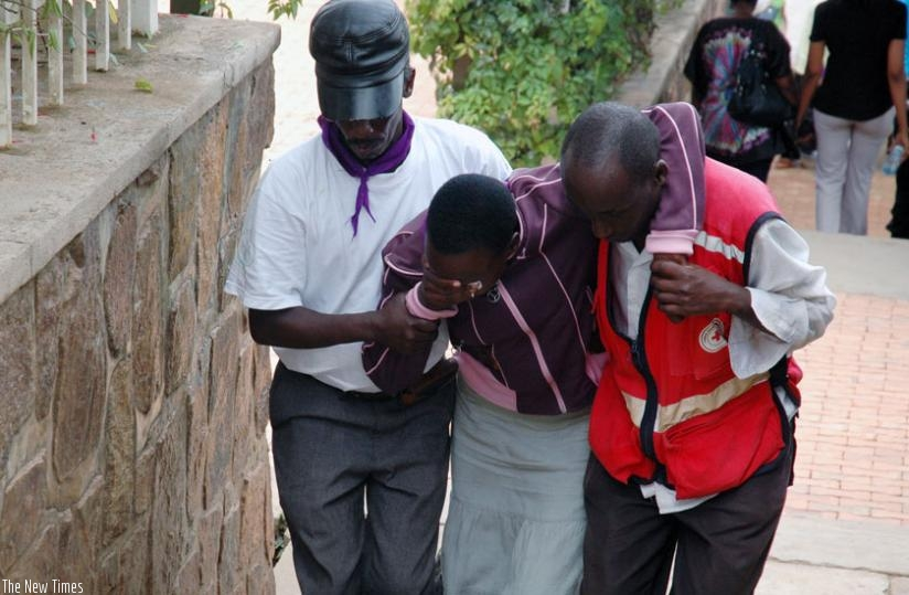 A trauma victim being taken away from a crowd at a commemoration in 2008. (File)