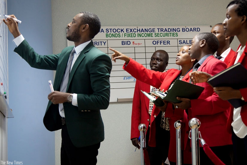 Brokers list shares at the Rwanda Stock Exchange recently. (File)
