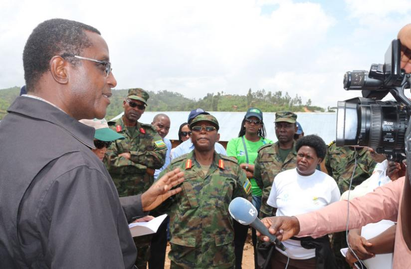 1429222288Minister-Biruta-addressing-the-media-as-army-officials-and-local-leaders-look-on