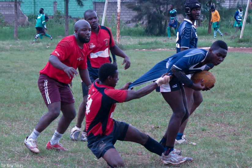 Muhanga's center Laurien Hakizimana tries to stop 1000 Hills' flyhalf Carlos Isimbi during the second half. 