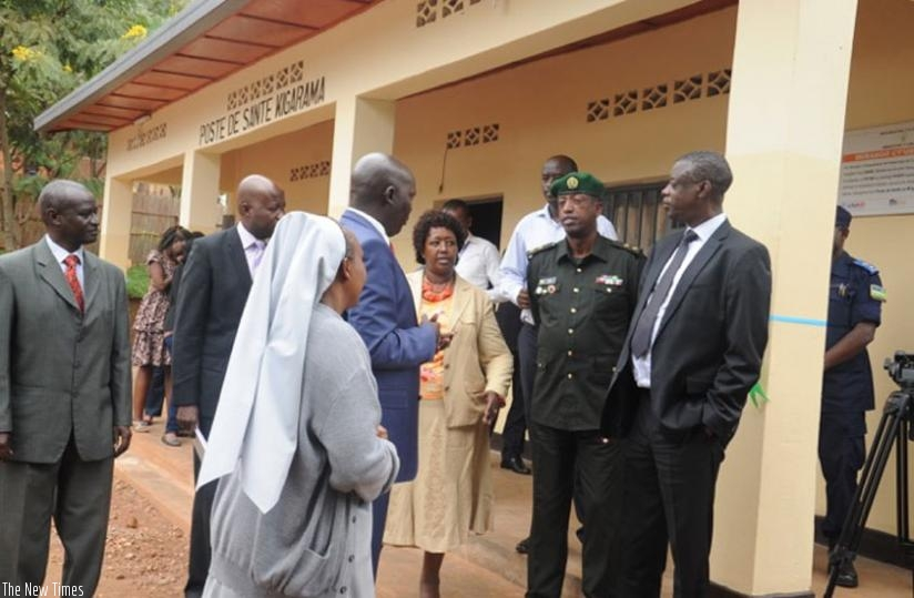 Dr. Binagwaho (C), Kabarebe (R) and other officials after the inauguration of Kigarama health post in Kicukiro District yesterday. (Ivan Ngoboka)
