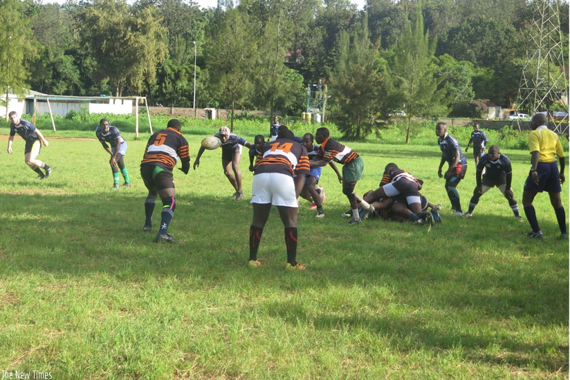 Remera Buffaloes (in striped jersey) won this year's rugby title after defeating Thousand Hills 17-10. (Stephen Kalimba)