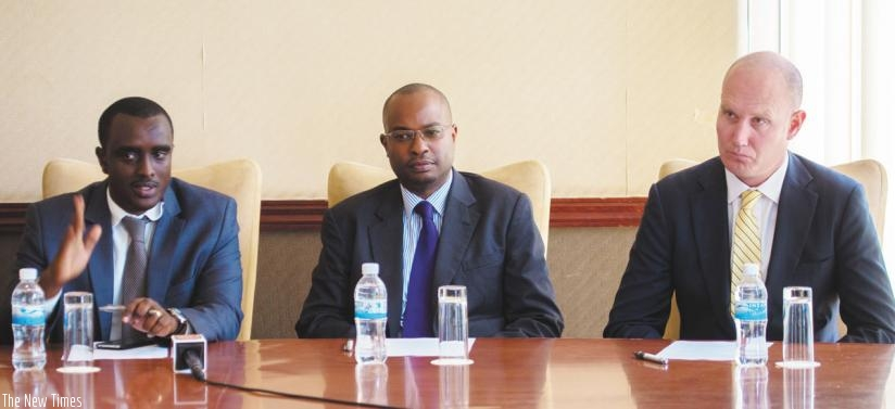 Aimable Nkuranga (left), the firm's country manager, speaks at the press briefing at the Kigali Serena Hotel, flanked by Steven Kamau, the business development manager and Grant Phillips, the chief executive. (Timothy Kisambira)