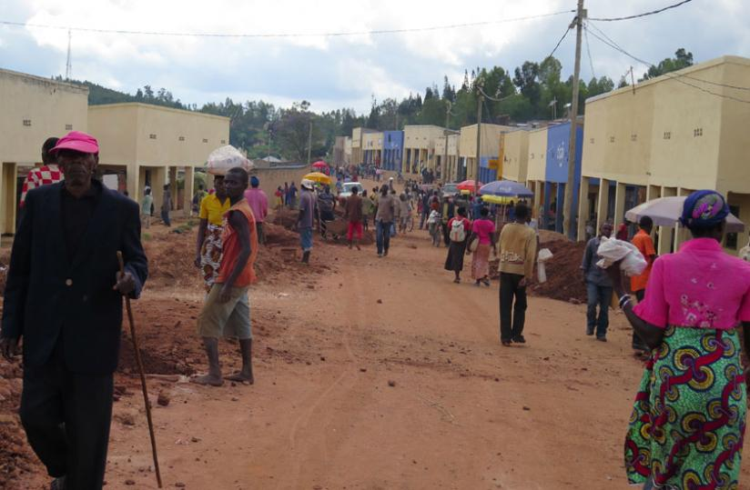 Locals at Musha trading centre, one of the areas set to benefit from the road. (Emmanuel Ntirenganya)