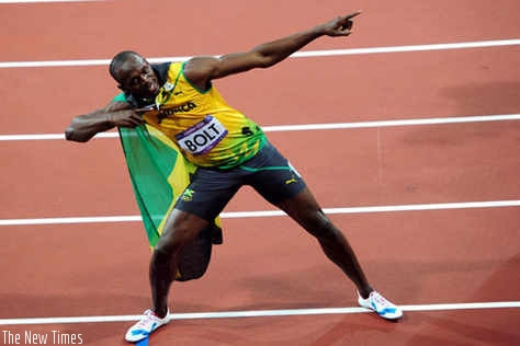 Jamaican sprinter Usain Bolt celebrates with his trademark signature. It takes a lot of commitment and dedication to achieve success such as has been attained by the runner. (File)
