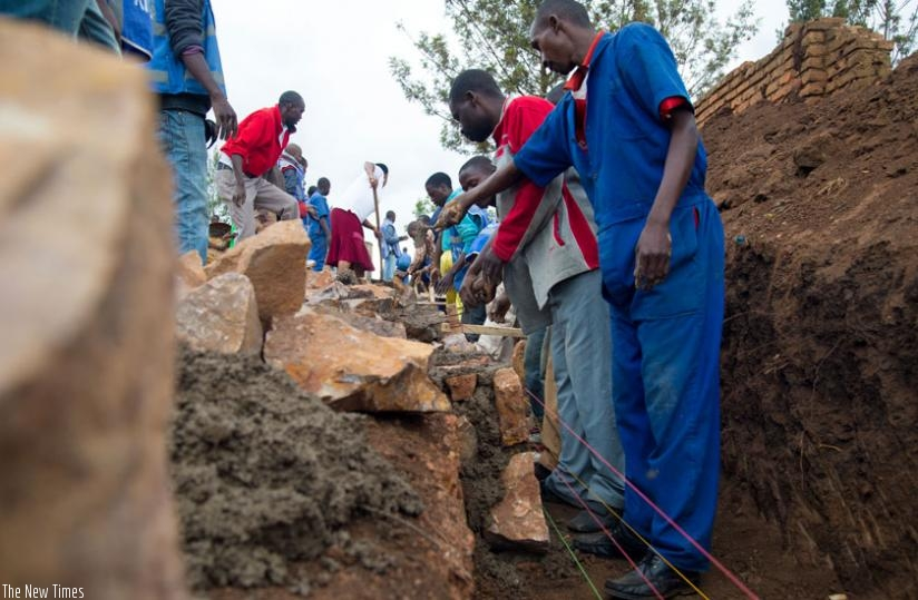 Residents of Kinyinya constuct a water trench during Umuganda in March.(Timothy Kisambira)
