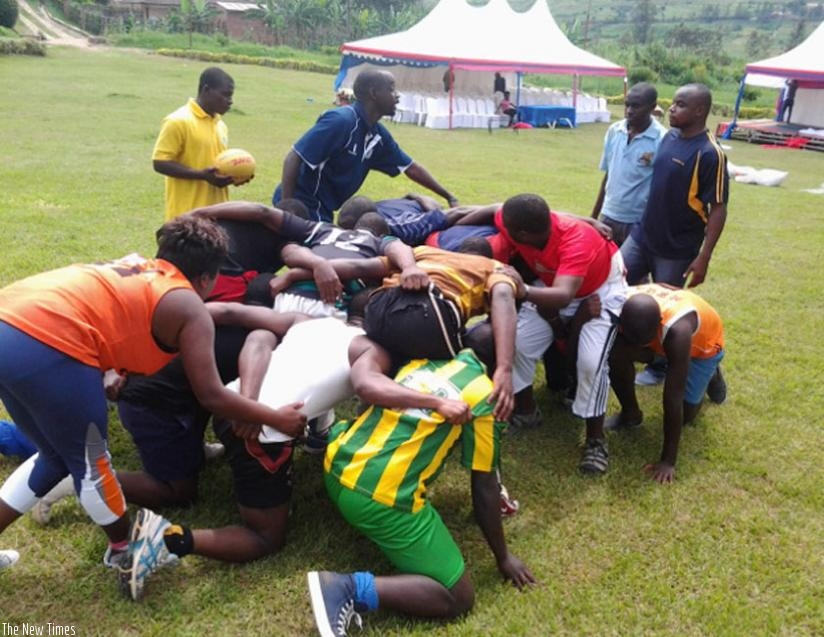 World Rugby instructor, Robert Bwali (standing 2nd from left) conducts a practical session with the coaches. (S. Kalimba)