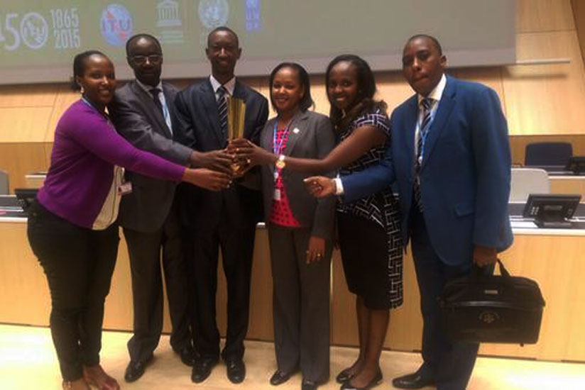 Rwanda Media Commission officials receive the award at a forum in Geneva.