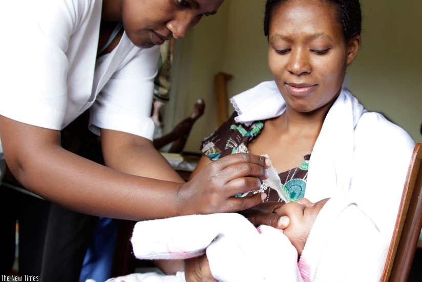 A nurse immunises a baby at Kacyiru Police Hospital. Rwanda is one of the few countries that achieved the MDGs deadline. (File)