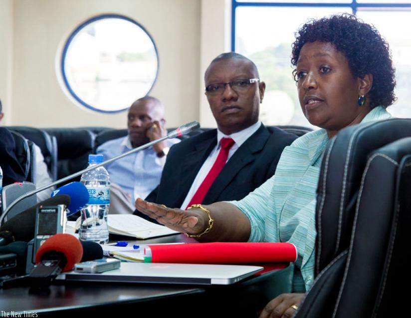 Dr Binagwaho (R) fields questions from journalists as Dr Patrick Ndimubanzi, the State Minister in charge of Public and Primary Health care, looks on during the news conference in Kigali on Wednesday. (D. Umutesi)