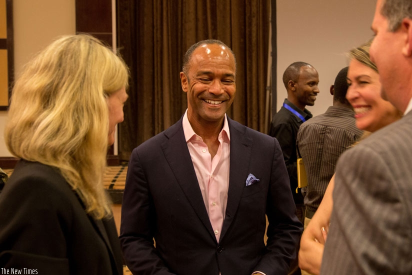 Pierre Prosper (C), the lead prosecutor in the Akayesu trial, shares a light moment with the US Ambassador to Rwanda after the premiere of The Uncondemned documentary. Prosper featured in the documentary. (Doreen Umutesi)