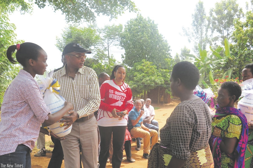 Biraro receives a present of a basket from the beneficiaries of his office's initiative. (Frederic Byumvuhore)