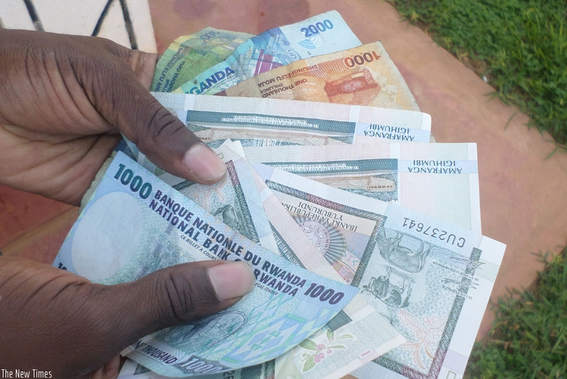 A forex delaer displays different currencies. The local unit lost 0.76 per cent % value in June. (File)