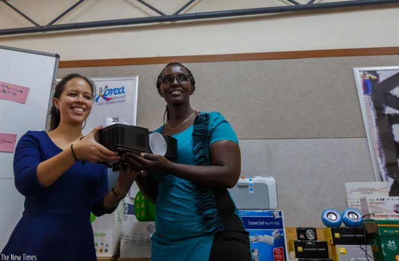Eva Juenemann ( L),  the labour market intervention advisor  at GIZ,  hands  over  a projector  to Agnes Mukamuligo,  the vice principal in charge of administration and finance at IPRC Kigali. (Timothy Kisambira)