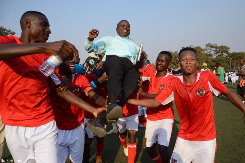 Bugesera  coach Noah Nsanziyinka is carried shoulder high by his players after guiding the club to the second divison league title on Saturday. (S. Ngendahimana)