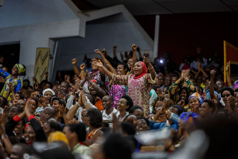 People applaud during the term-limit amendment session at Parliament last week. (T. Kisambira)