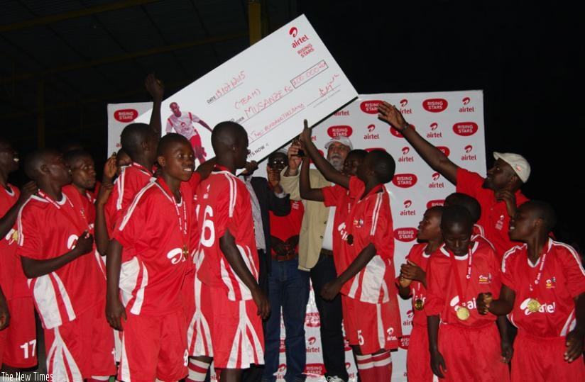 Inyange Academy  players celebrate after winning the 2015 Airtel Rising Stars season III national football title in the boys category on Sunday. (Courtesy)