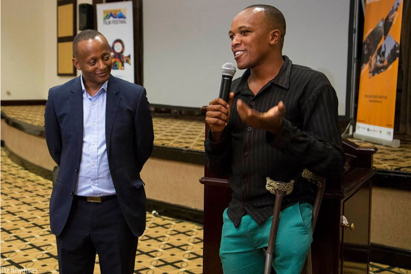 Rwanda Film Festival chairperson, Eric Kabera, with the inspirational star of one of the opening night short films, Rayisi (Photos by RFF)
