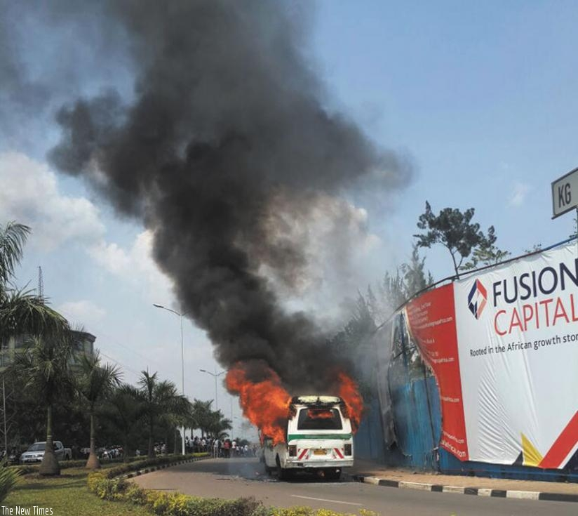 A commuter taxi that burst into flames last year in Kacyiru.  Some insurers are still underpricing motor vehicle third party policies, a vice that is hurting the sector. (File)