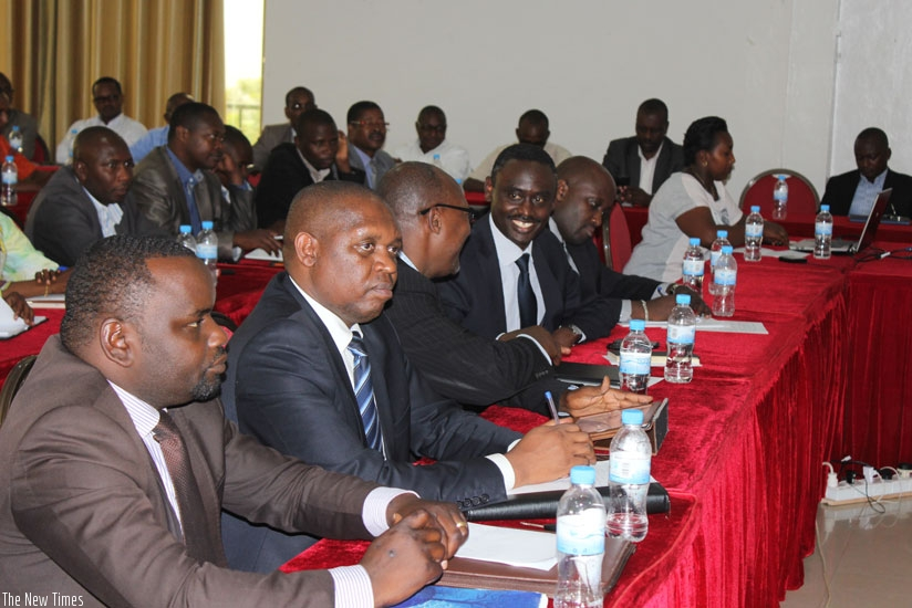 Representatives of government and development partners at the meeting in Kigali. (Frederic Byumvuhore)