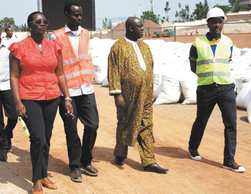 The Minister of Sports and Culture UWACU Julienne (L), FERWAFA president Vincent Nzamwita (R) along with CAF officials on their last visit and inspection of Kigali regional stadium. (File)