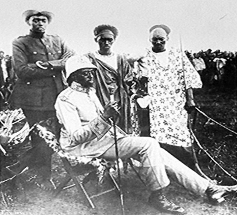 King Musinga (seated) and Rudahigwa (left) standing. (Courtesy)
