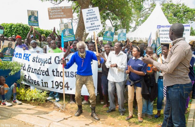 Protesters hold signs during a demonstration outside the British High Commission in Kigali call for the release of Gen. Karenzi Karake in June. (File)